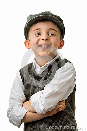 Young boy laughing with flat cap