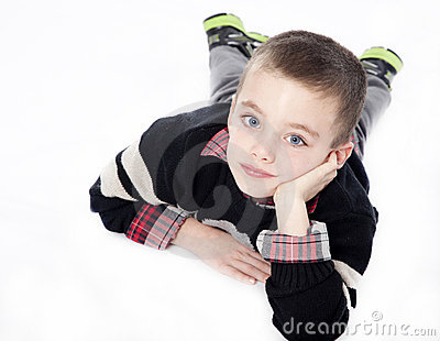 Young boy laying down in studio