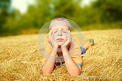 Young boy laying on ground