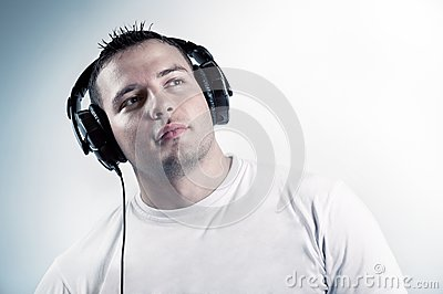 Young boy listening music in headphones