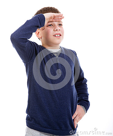 Young boy looking into the distance