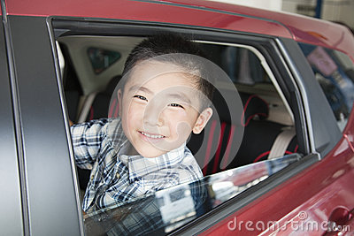 Young Boy Looking Out a Car Window