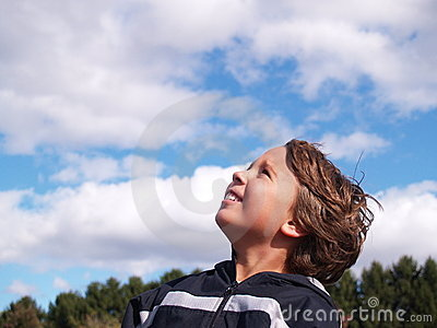 Young boy looking skyward