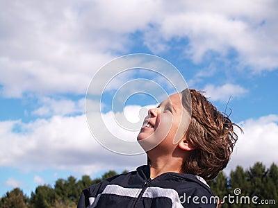 Young boy looking skyward