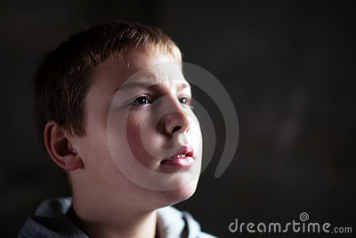 Young boy looking up with hope in his eyes