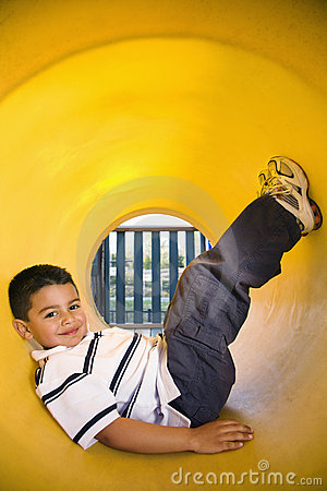 Young Boy Lying in Crawl Tube