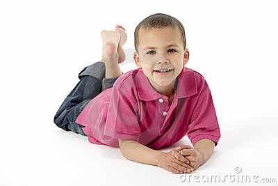 Young Boy Lying On Stomach In Studio