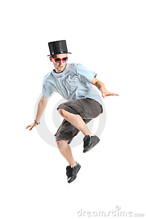 Young boy with magic hat in jump
