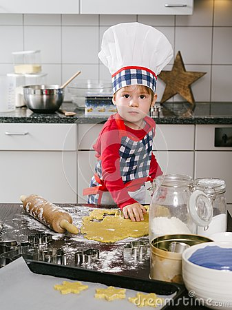 Young boy making cookies