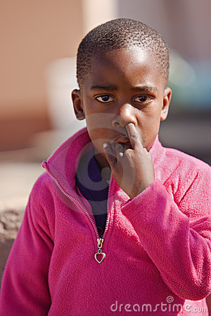 Young boy picking nose