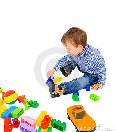 Young boy play with bricks