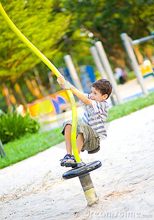 Young boy on playground activity,