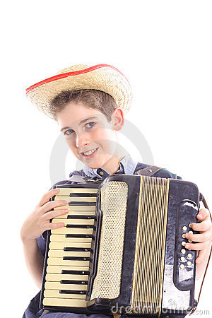 Young boy playing an accordion