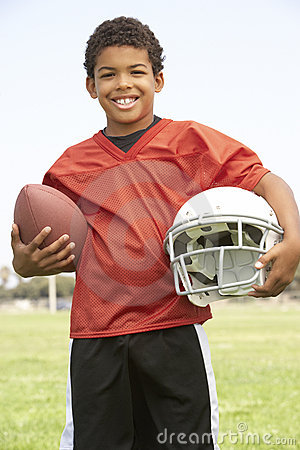 Free Young Boy Playing American Football Royalty Free Stock Photo - 12406235