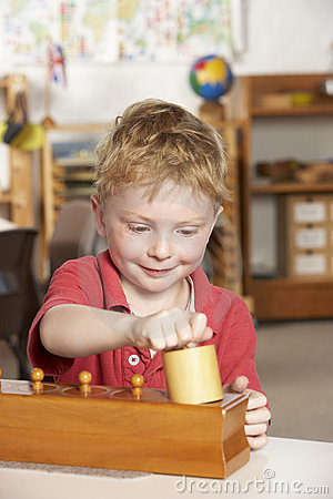 Free Young Boy Playing At Montessori/Pre-School Stock Photos - 10971753