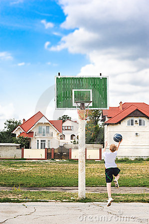 Free Young Boy Playing Basketball Alone Royalty Free Stock Photo - 10731375