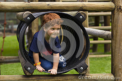 Young boy playing on a jungle gym