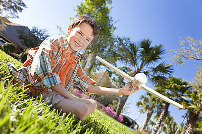 Young Boy Playing WIth Model Airplane Outside