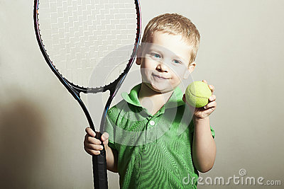 Young Boy Playing Tennis. Sport Children. Child with Tennis Racket and Ball