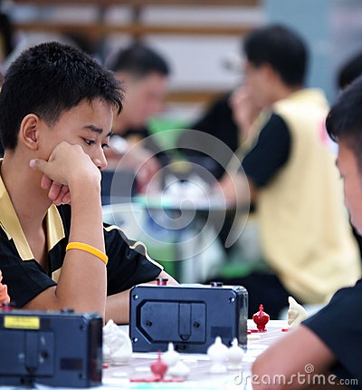 Young boy playing Thai chess