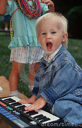 Young boy playing toy piano Editorial Photo