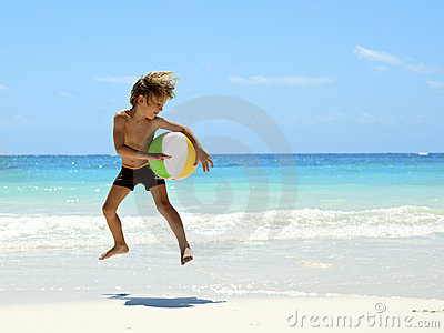 Young boy playing on the tropical beach