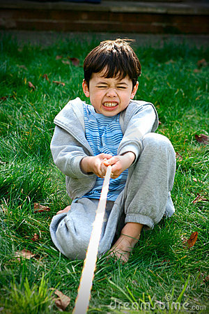 Young boy playing tug-of-war