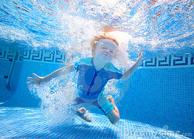 Young boy playing underwater