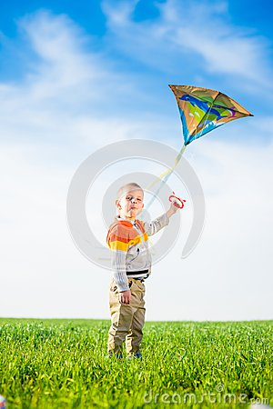 Free Young Boy Playing With His Kite In A Green Field. Stock Image - 108164321