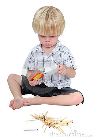 Free Young Boy Playing With Matches On A White Background Stock Images - 1455834