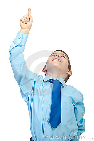 Young boy pointing up to copy space