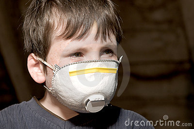 Young boy with pollution mask