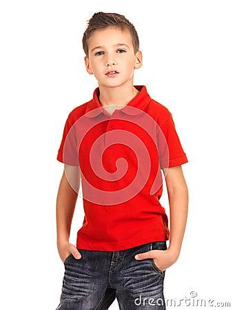 Young boy posing at studio as a fashion model.
