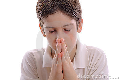 Young boy praying on white center