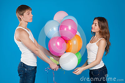 Young boy presenting baloons to a girl