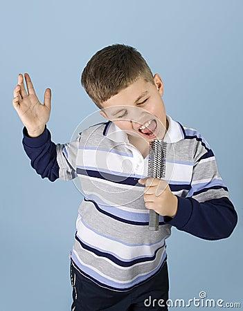 Young boy pretending rock star