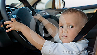 Young boy pretending to drive