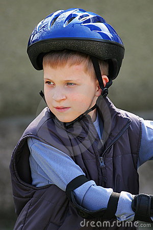 Young boy in protective helmet