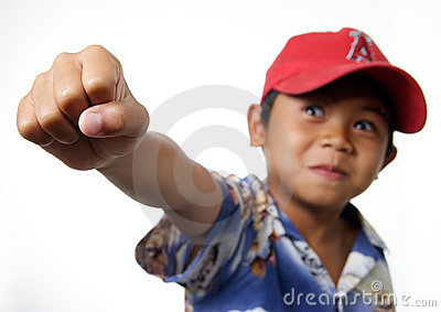 Young boy raising fist victorious