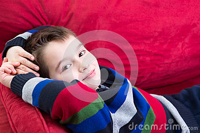 Young Boy on the Red Couch
