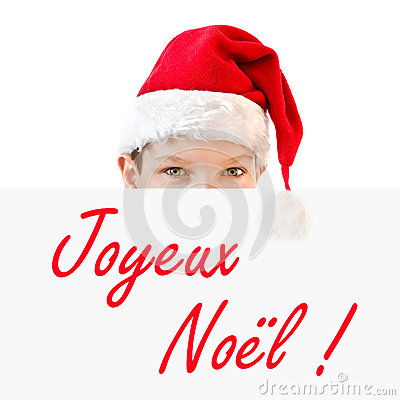 young boy in red santa hat and joyeux noel stock photo. Black Bedroom Furniture Sets. Home Design Ideas