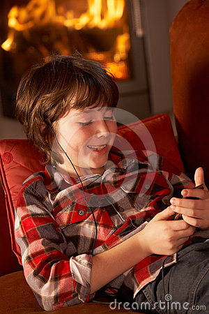 Young Boy Relaxing With MP3 Player