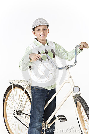 Young boy on a retro bike