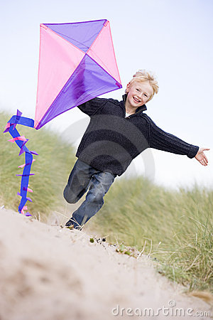 Free Young Boy Running On Beach With Kite Smiling Royalty Free Stock Images - 5937439