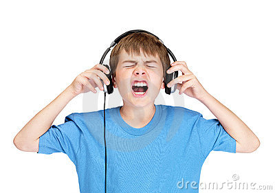 Young boy screaming while listening to music on he