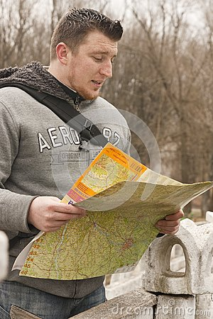 Young boy search destination on the map