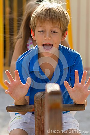 Young boy on the seesaw