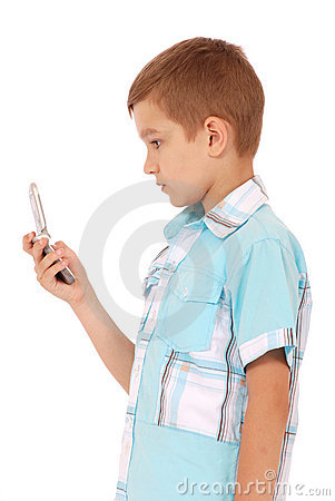 Young boy send text message with phone