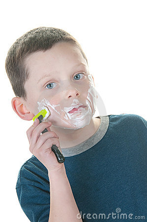Young boy shaving