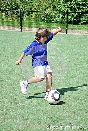 Young boy shooting ball